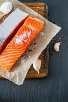 Salmon fillet with salt, pepper, garlic photo