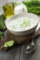 Summer soup with cucumbers, yogurt and fresh herbs