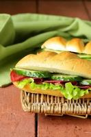 Fresh sandwich with smoked meat, cucumber and lettuce