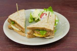 Sanwich with chiken, cheese and vegetables photo