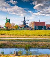 Authentic Holland architecture on the water channel in Zaanstad village