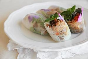 Homemade rice paper rolls with edible flowers