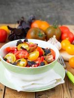 salad of colorful tomatoes on a wooden background