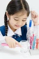 Asian student making science experiments