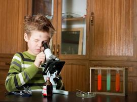 Little boy making science experiments. Education.