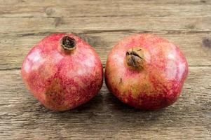 Pomegranate isolated on wooden background photo