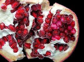 Pomegranate fruit in bubbles photo