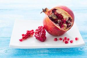 Pomegranate on plate  wooden background