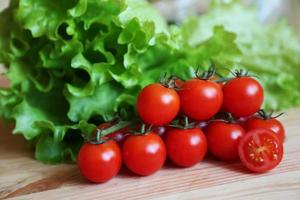 tomatoes and lettuce leaves photo