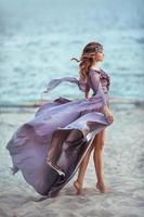 Beautiful Girl In A Fairy Purple Long Dress photo