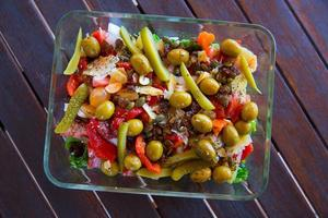 Mediterranean salad with tomato olives cucumber lettuce
