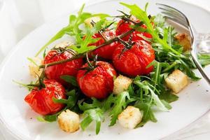 salad of arugula and croutons. photo