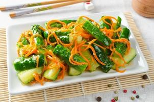 Cucumber salad with carrots photo