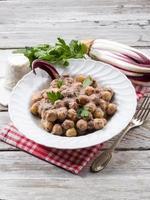 gnocchi with chicory and ricotta sauce photo
