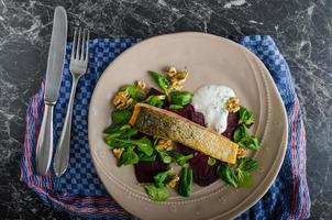 Fried salmon with herbs and beets