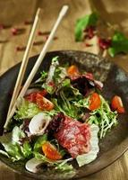 Warm salad with cutting of a marbled beef