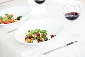Greek salad on white plate, close up photo