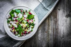 Vegetable salad on wooden background photo