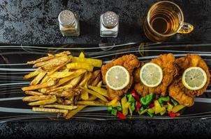 Schnitzel with french fries photo