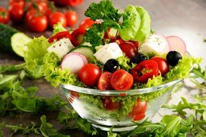 Vegetable salad bowl on kitchen table. Balanced diet photo