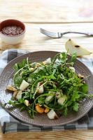 juicy fresh salad with arugula and pear photo