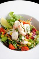 octopus salad with lemon slice lettuce