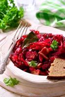 Beetroot and cabbage stewed with sausage and smoked bacon.