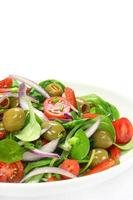 Salad of lamb's lettuce, olives, paprika, tomato and onion photo