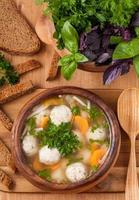 Traditional soup with meatballs and vegetables