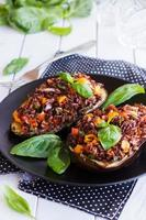 Stuffed eggplant with red rice and vegetables photo