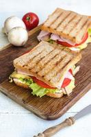 Tasty healthy sandwiches at white wooden table. Rustic style. photo
