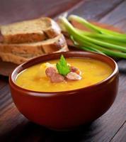 Pea soup in ceramic bowl photo