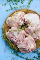 Raw chicken legs photo