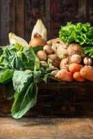 Organic vegetables box on old wooden background