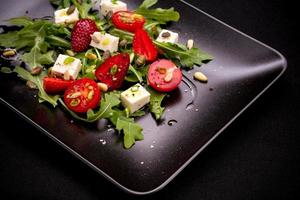 Strawberry tomato salad with feta cheese, olive oil photo
