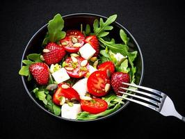 Strawberry tomato salad with feta cheese photo