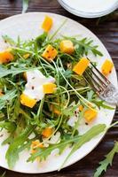 fresh salad with pumpkin and yogurt photo