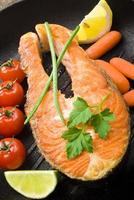 salmon steak with vegetables photo