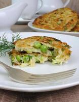 Fritters of zucchini and peas photo