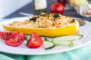 stuffed zucchini with chicken and vegetables, horizontally, yellow