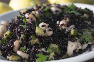 Venus black rice with prawns and courgettes photo