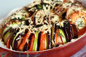 baked sliced vegetables with cheese photo