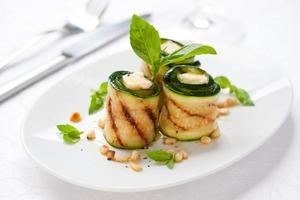 Zucchini rolls with cheese on plate