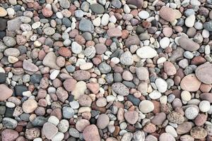 Textura de fondo de roca de piedra pequeña foto