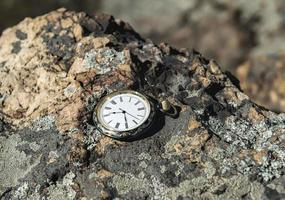 Watch on rocks photo