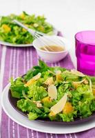 salad with spinach, oranges and nuts photo