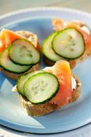 Canapes with salmon fresh cucumber and creamy cheese