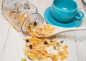 Cornflakes Caramel with milk. Selective focus, shallow DOF photo