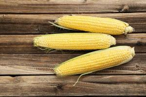 Corns on a brown wooden background