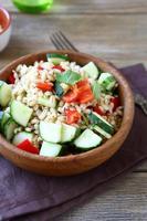 Pearl barley salad with fresh vegetables photo